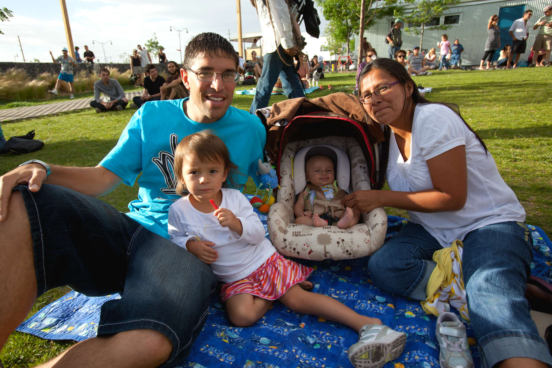 REEL FATHERS-Father's Day Fiesta: Family relaxes before movie on performance green