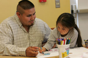 REEL FATHERS--Dads and Kids Night: Father and daughter enjoy art project together