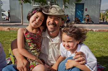 REEL FATHERS-Father's Day Fiesta: Dad with 2 young daughters enjoying being together