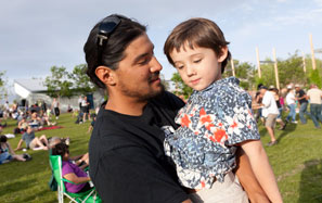 REEL FATHERS-Father's Day Fiesta: Father gazes on young daughter held in his arms